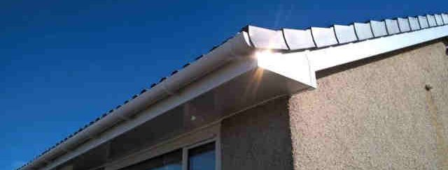 White fascia's, soffit and round guttering.